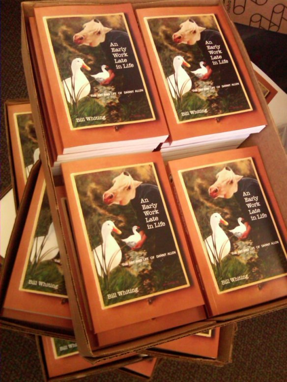 Piles and piles of books reading for shipping to upcoming book signing sites.